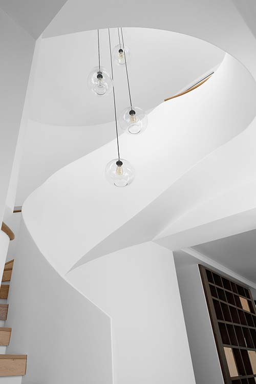 Modern white staircase inside a two-storey Australian addition - design by Luigi Rosselli Architects