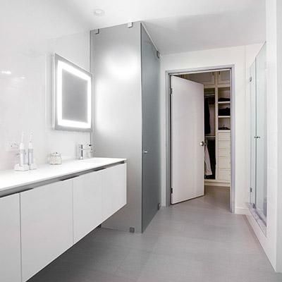 Modern white bathroom in Los Angeles twin loft by CHA:COL