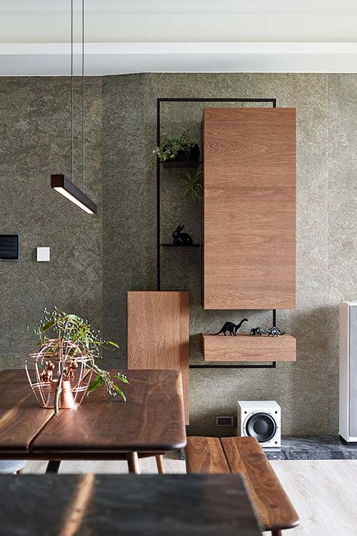 Modern furniture was chosen for the living area inside this small home located in Taiwan