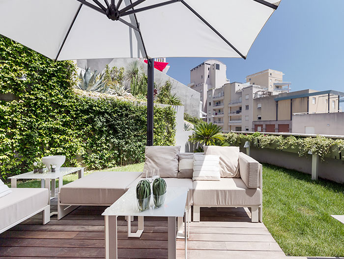 Amazing outdoor lounge area in modern, spacious apartment near Monaco for a relaxing and lavish stay on the French Riviera