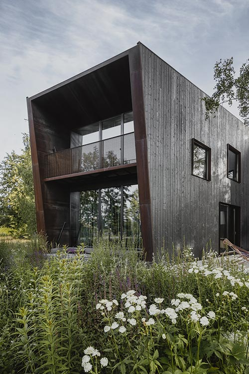 Architects' House by Open AD: Modern timber house in Latvia