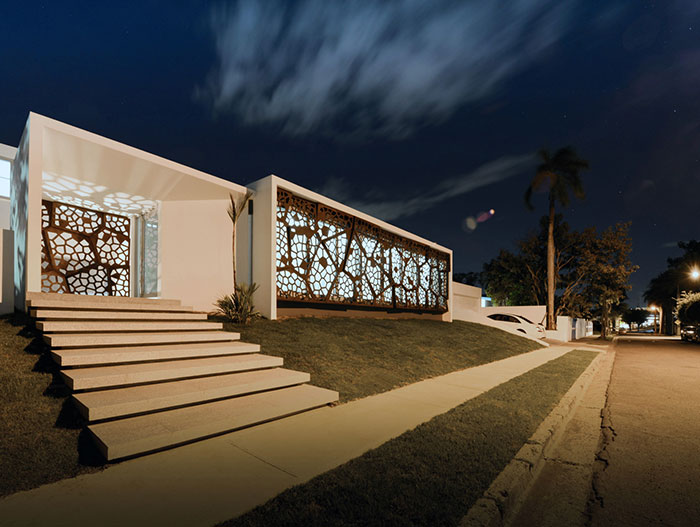 Puerto Rican villa entrance night view - award-winning renovation project by Diaz Paunetto Architects