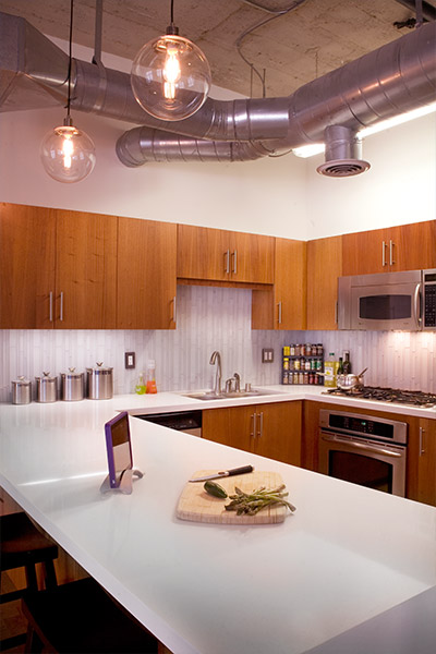 Modern kitchen design in South Park loft shelving system - Unit was remodeled on a limited budget by CHA:COL