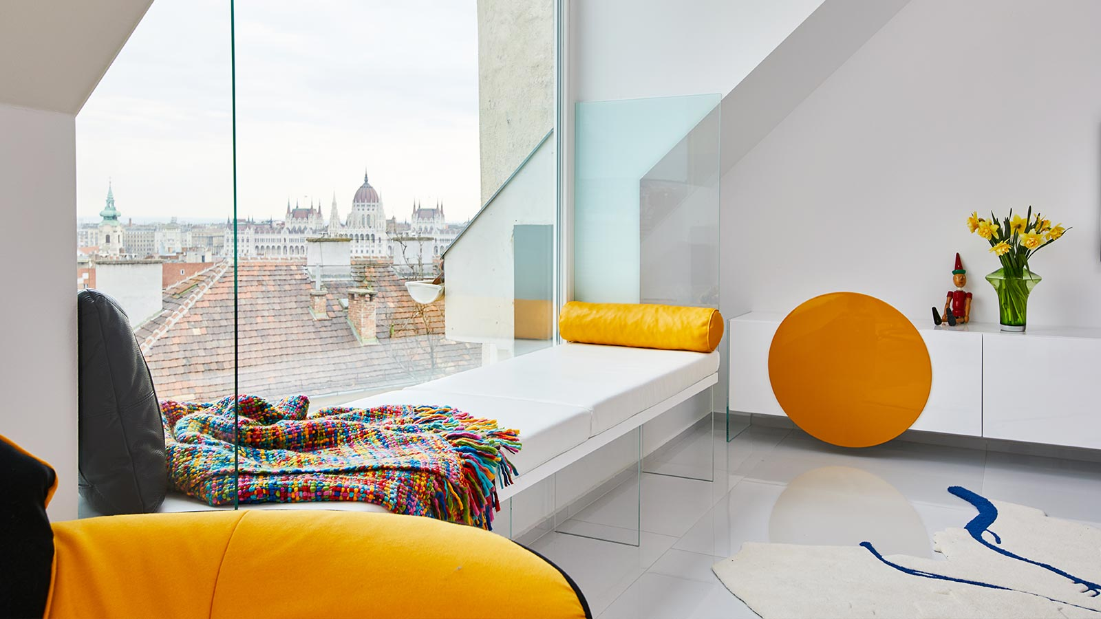 Renovated apartment in Budapest, Hungary by Margeza boasts custom furniture and impressive views