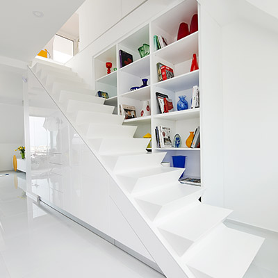 White staircase in renovated apartment located Budapest, Hungary