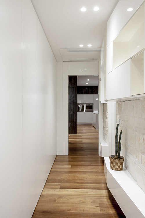 Modern hallway leading to the bedroom in a renovated apartment in Italy