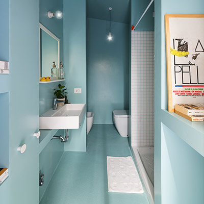 Functional small turquoise blue bathroom in small 28 square meter apartment in Milan, Italy by Studio WOK
