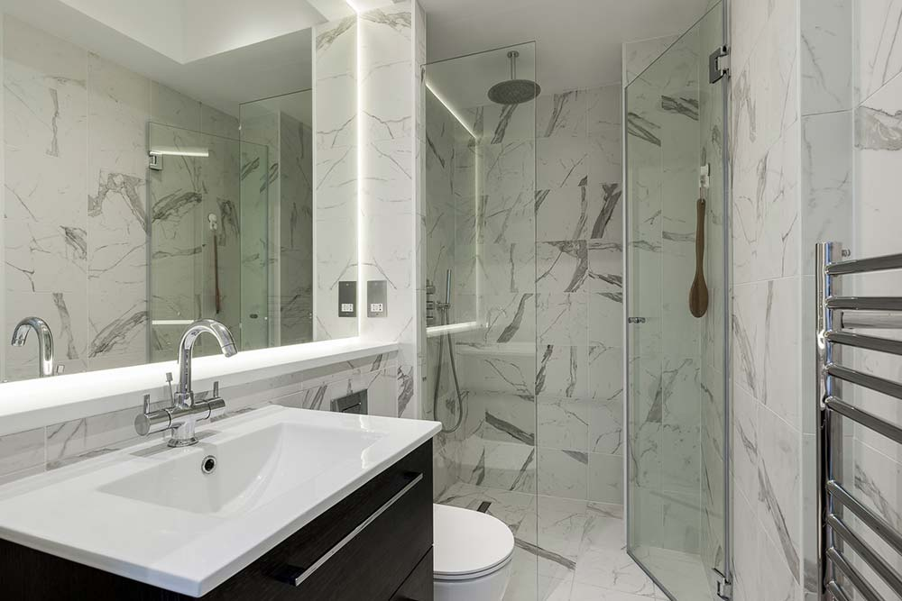 Install tiles all the way up to the ceiling to make your bathroom look bigger
