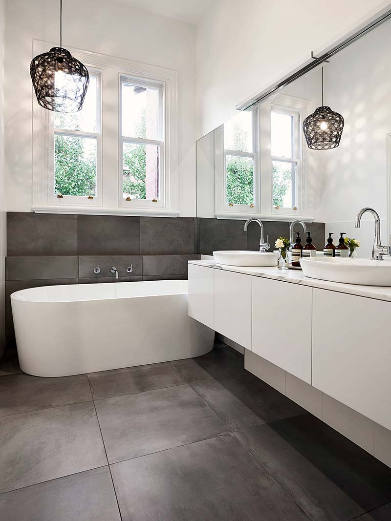 Use large floor tiles to make your small bathroom look larger