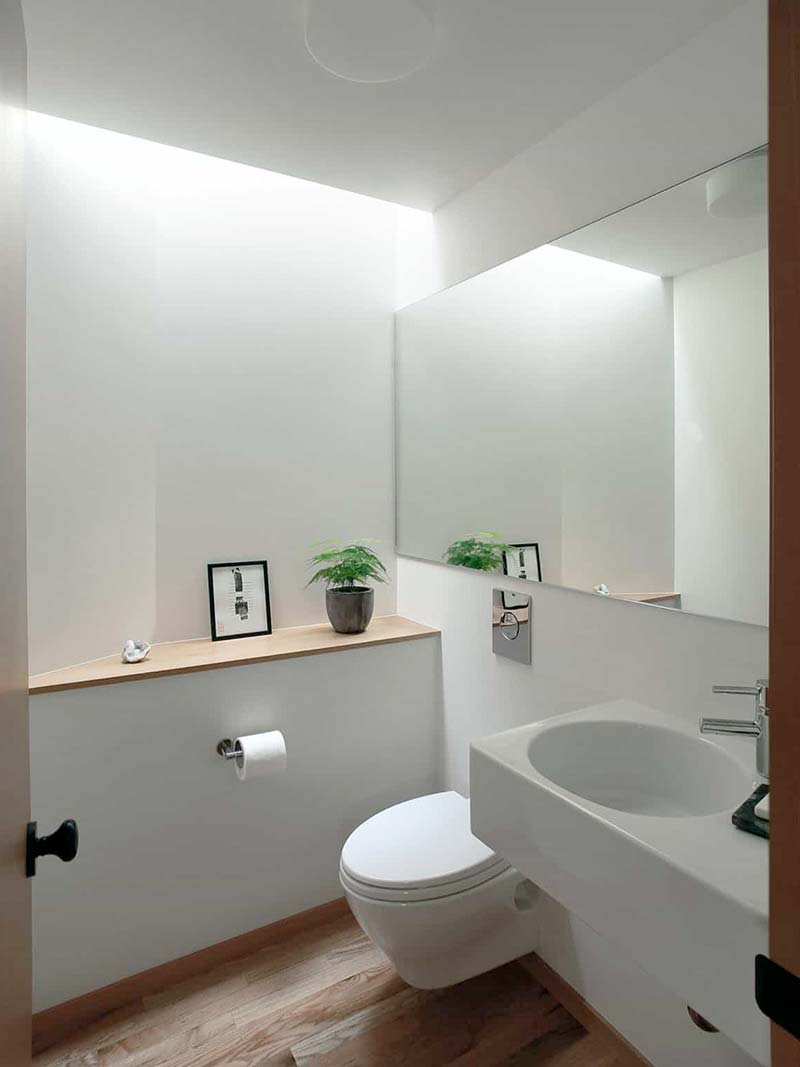 Small bathroom ideas - add a large mirror to make your bathroom look larger than it is
