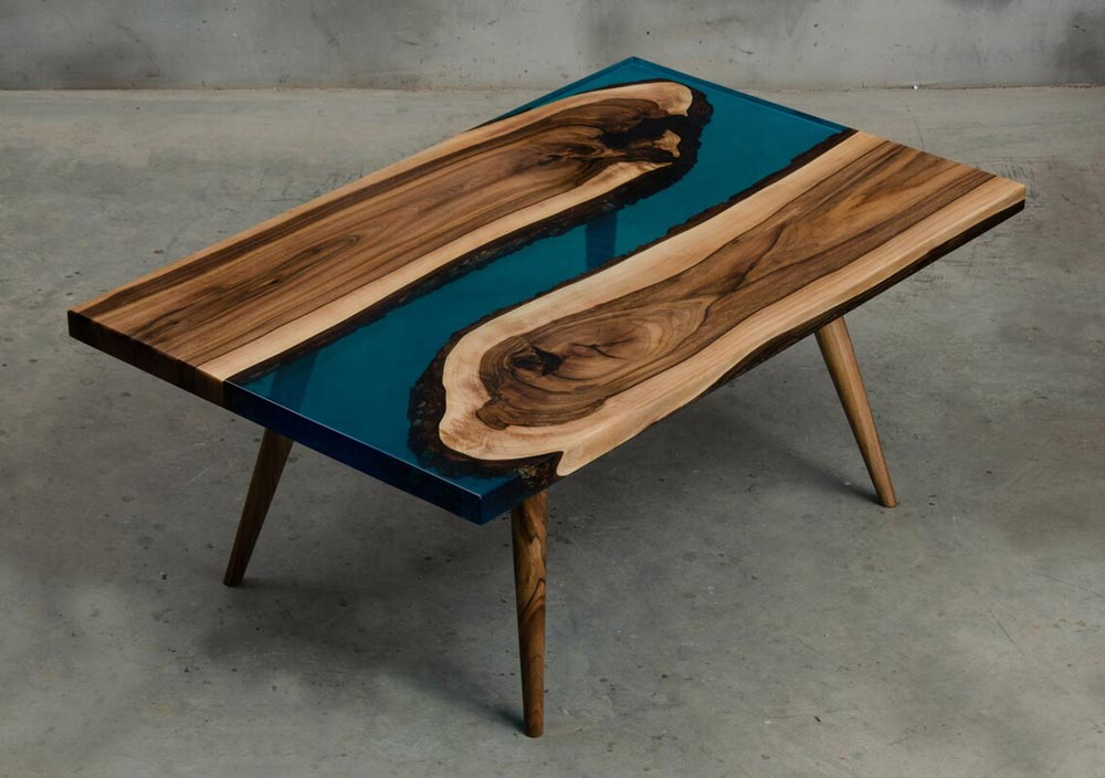 Small epoxy resin table made of walnut wood and blue UV resin for sale perfect for a modern living room