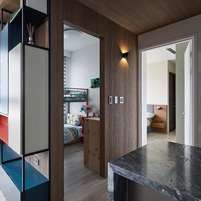 Small hallway leading to the bedrooms inside a small home - design by Awork.Design Studio