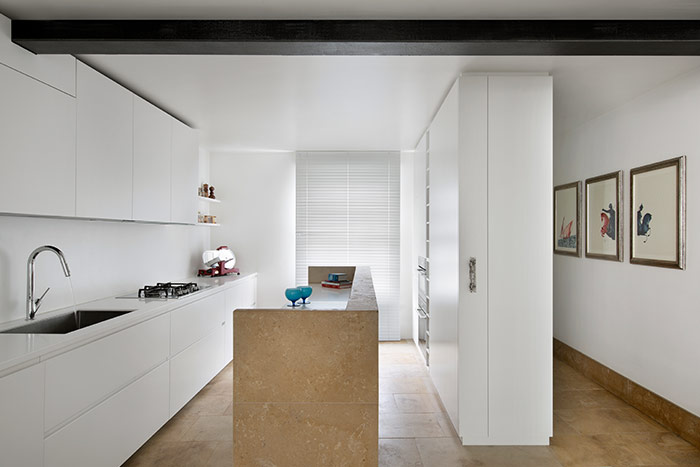 Small white kitchen design idea in a renovated house in London - by extrArchitecture
