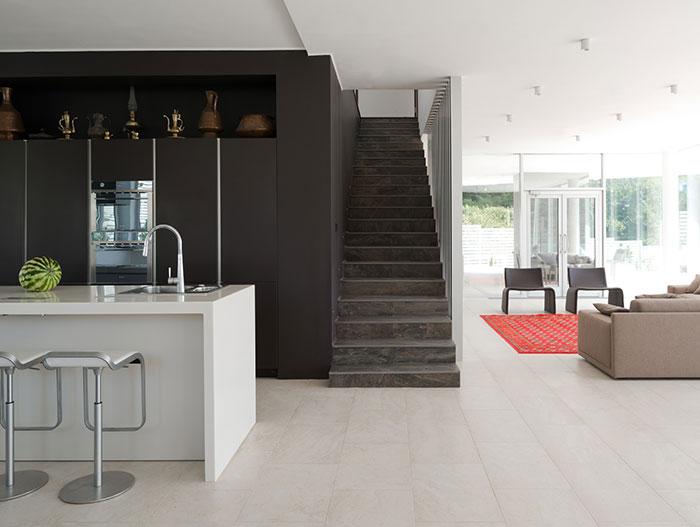 Modern staircase near kitchen area in contemporary Sochi, Russia villa