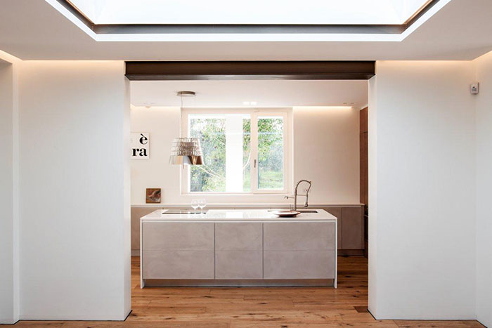 Modern kitchen design idea in a sophisticated home in perfect balance with the surrounding environment - located in Italy, renovated by m12 AD