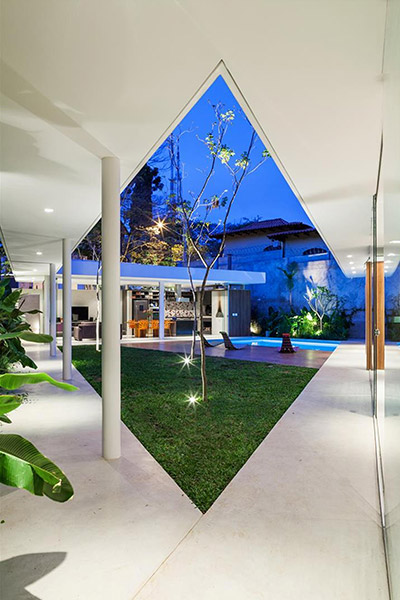 Spectacular house in Sao  Paulo, Brazil  by FGMF Architects - intended as a multigenerational family home where members can reunite, sunbathe near the pool and enjoy this lavish central courtyard