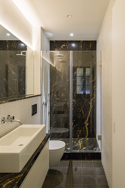 Modern bathroom design idea in a stunning apartment in Barcelona - House of Mirrors by Nook Architects