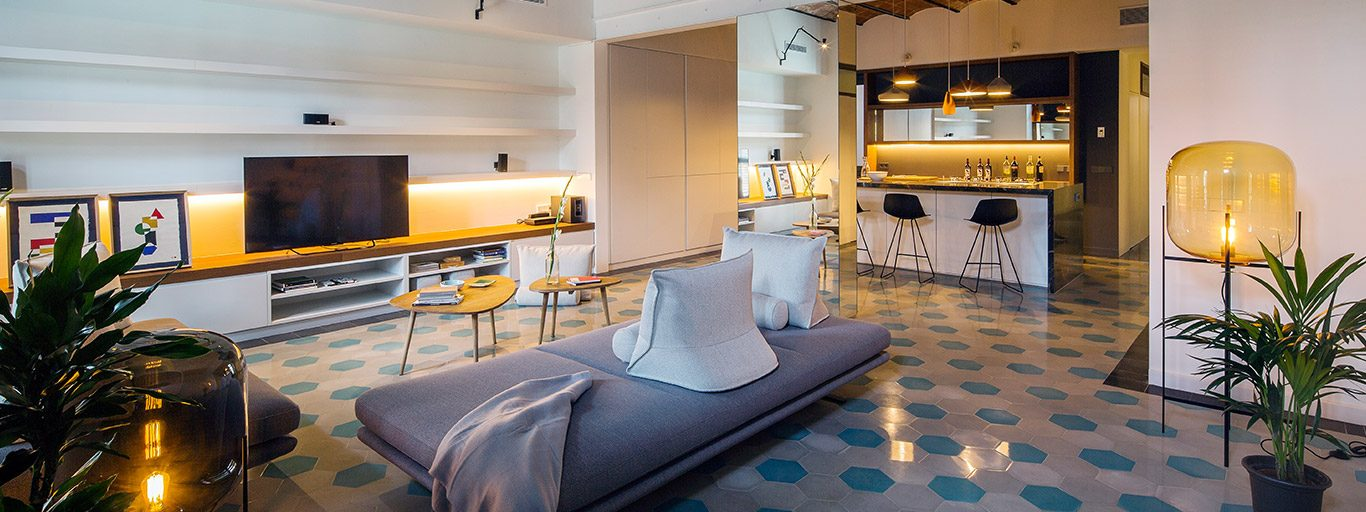 Stunning apartment in Barcelona benefits from the use of mirrors to amplify space and light - designed by Nook Architects