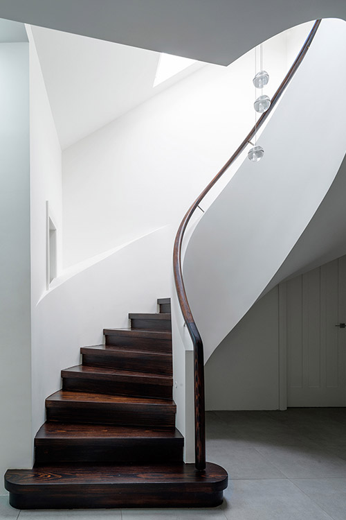 Modern spiral staircase in a stunning dwelling composed of 2 apartments located in Sydney, Australia