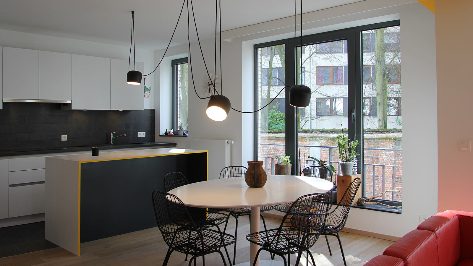 This apartment in Brussels uses cleverly designed furniture to maximize storage space