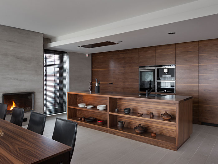Stylish modern kitchen design finished in American walnut - Two Levels project by NOTT Design