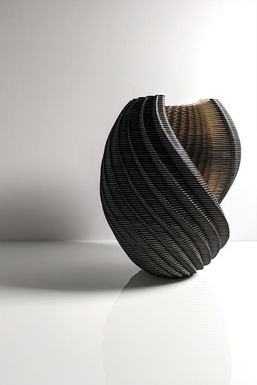 Laser-cut paper vessel by Ibbini Studio