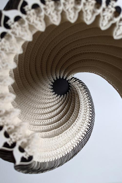 Laser-cut paper vessels created by Ibbini Studio