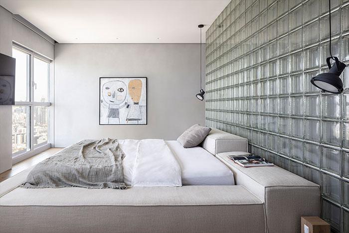 Modern bedroom in a bright duplex apartment in Tel Aviv, Israel