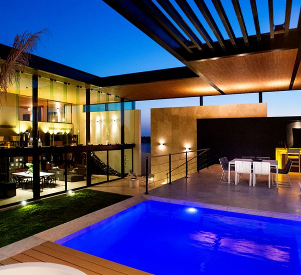 This amazing house by Seijo Peon Arquitectos boasts impressive pool above the garage