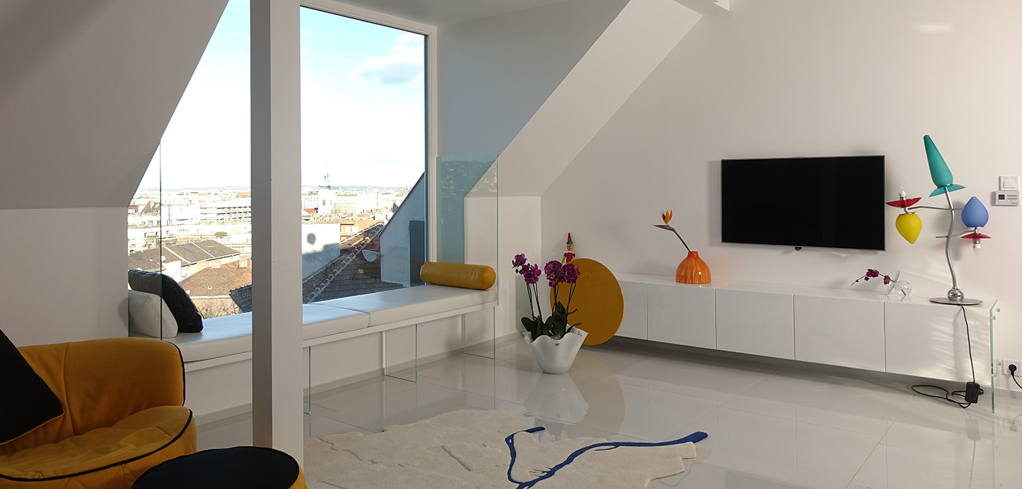 White living room design idea in a renovated apartment located in Budapest, Hungary