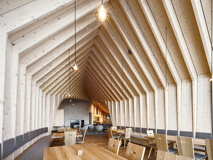 This wooden restaurant located in the Italian Alps offers great food and stunning mountain views